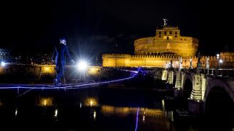 An Italian tightrope walker has inched his way across the Tiber River in Rome. Andrea Loreni's high-wire act drew gasps of delight from crowds watching from below on Sunday evening.