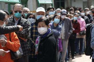 Elderly residents and handicapped people in Hong Kong received face masks for free.