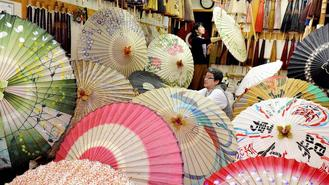 Craftsmen work on wagasa traditional Japanese umbrellas at a wagasa shop in Kanazawa, Japan, as production of the umbrellas reached its peak.