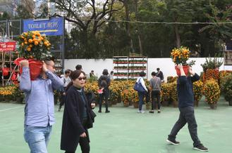 Citizens come to visit the Lunar New Year Fair at Victoria Park, Hong Kong, Jan 20, 2020.
