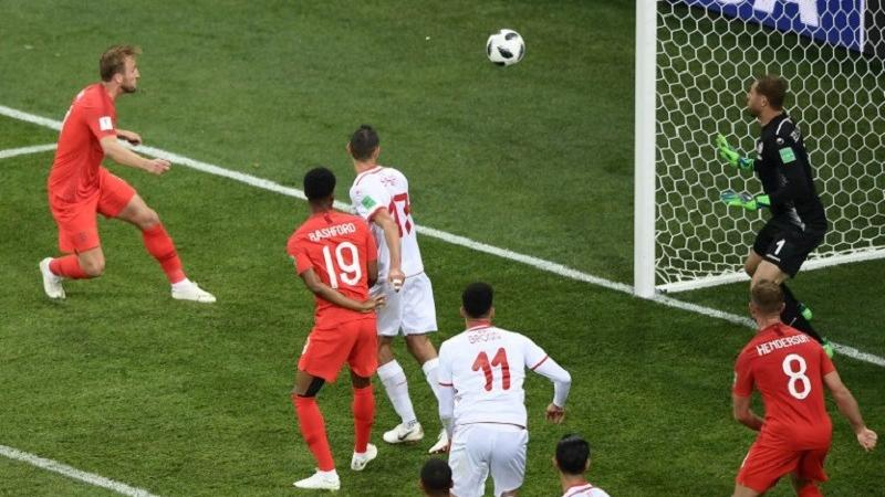 England s forward Harry Kane (left) heads the ball and scores his second  goal during the Russia 2018 World Cup Group G football match between Tunisia  and ... 8d3c863b9