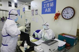 At the Wuhan Parlor facility, the largest mobile cabin hospital in Wuhan, Hubei province, medical workers from around the country are treating mild novel coronavirus pneumonia cases.