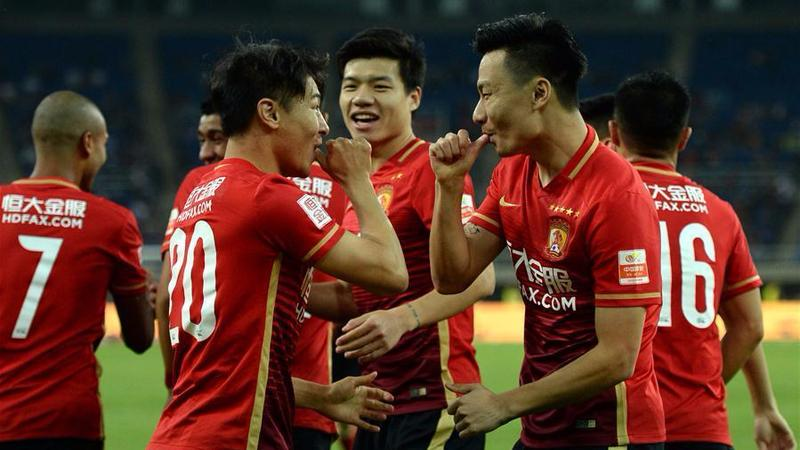 5789f8482 Players of Guangzhou Evergrande celebrate after scoring during the sixth  round of the Chinese Super League between Guangzhou Evergrande and Tianjin  Teda in ...