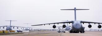 Eleven transport aircraft of the People's Liberation Army Air Force, including six large, domestically developed Y-20 planes, headed a massive operation to send 1,400 medics and supplies from seven cities to Wuhan, Hubei province, on Thursday.