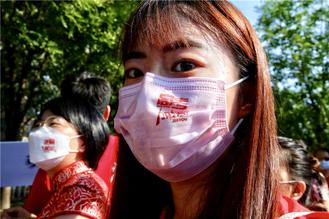Students should have their temperature checked before entering test sites and wear masks throughout the exams.