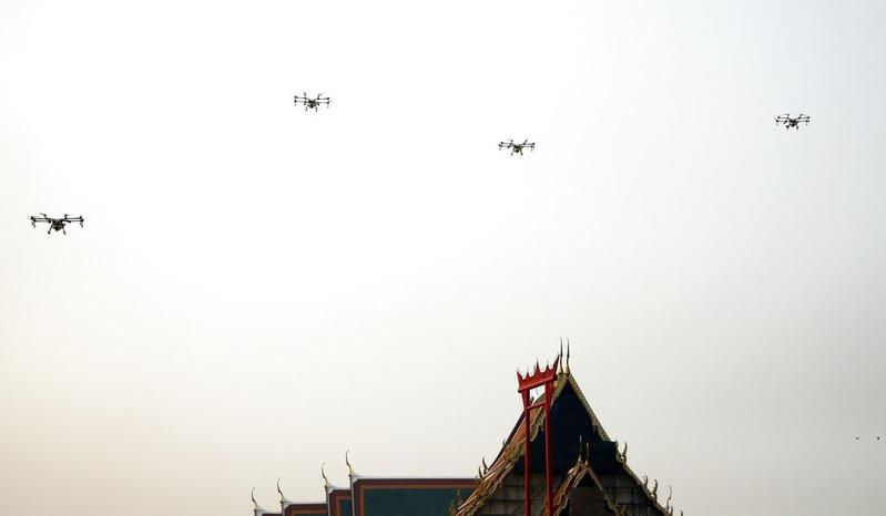 f617f24ff75 Water-spraying drones fly over the Suthat Temple in Bangkok, Thailand, Jan  31, 2019. (SAKCHAI LALIT / AP)