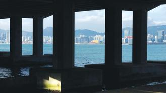 A photo from the Island Eastern Corridor captures the landscape across Quarry Bay bathed in afternoon sunshine.
