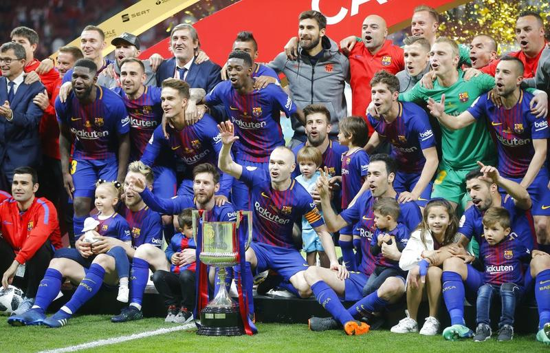 fc750f3b3 FC Barcelona's Andres Iniesta, centre, with teammates as they celebrate  during an award ceremony after defeating Sevilla 5-0 in the Copa del Rey  final ...
