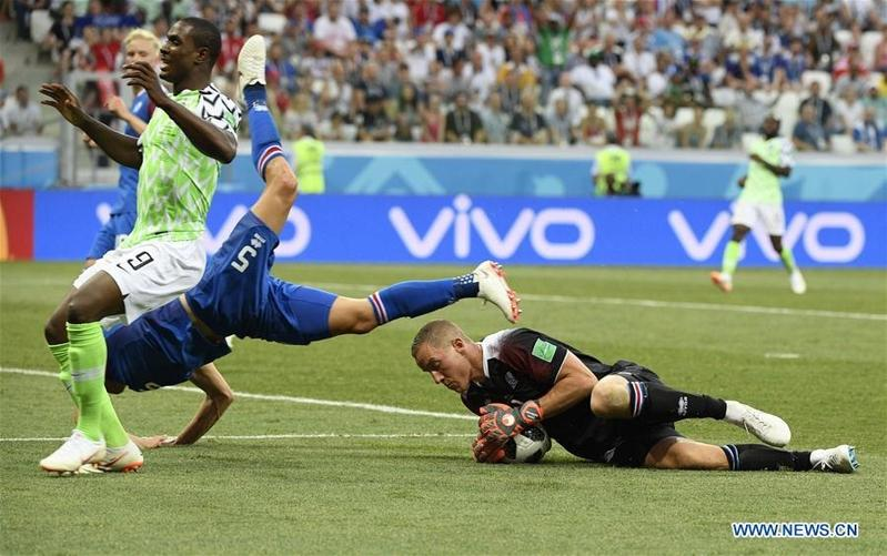 752646e88cb Iceland's goalkeeper Hannes Halldorsson (right bottom) defends during the 2018  FIFA World Cup Group D match between Nigeria and Iceland in Volgograd,  Russia ...