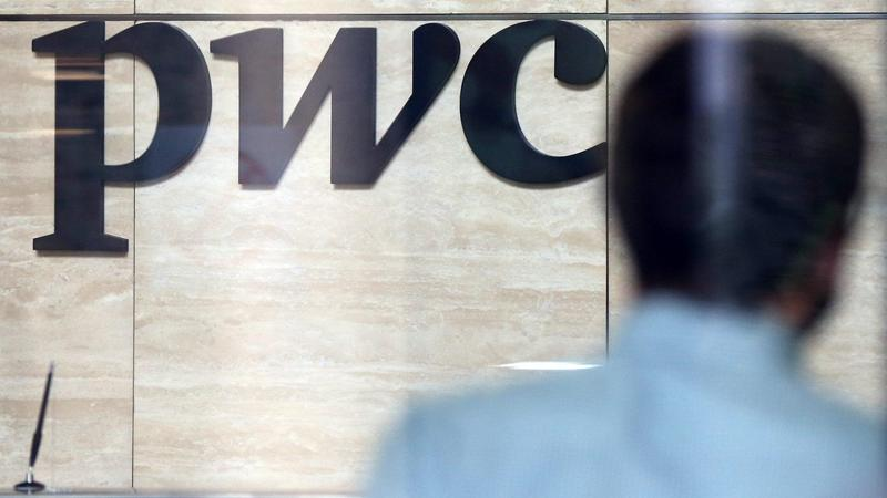 The Undated Photo Shows A PwC Logo Behind A Reception Desk. (ARTYOM  KOROTAYEV / GETTY IMAGES)