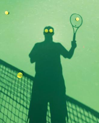 A tennis player takes a selfie with his shadow at a tennis court in Quarry Bay. The result was apparently a well orchestrated and amusing image, where two balls became his silhouette's eyes.
