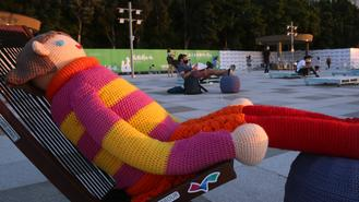 A yarn doll is seen on an easy chair on a sunny afternoon in Kennedy Town on Hong Kong Island.
