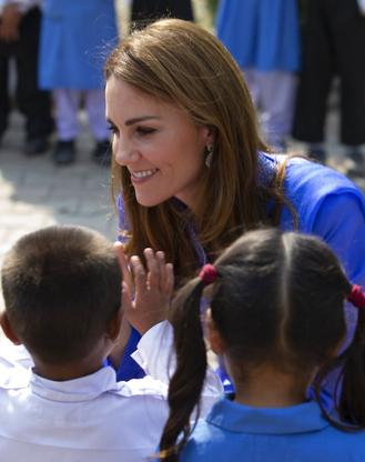 The Cambridges, who are strong advocates of girls' education, were greeted by teachers and children on their arrival at the Model College for Girls.