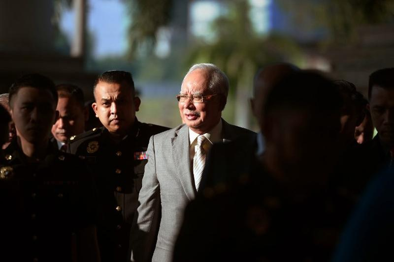 Ex-Malaysian PM Najib to face charge for tampering 1MDB report