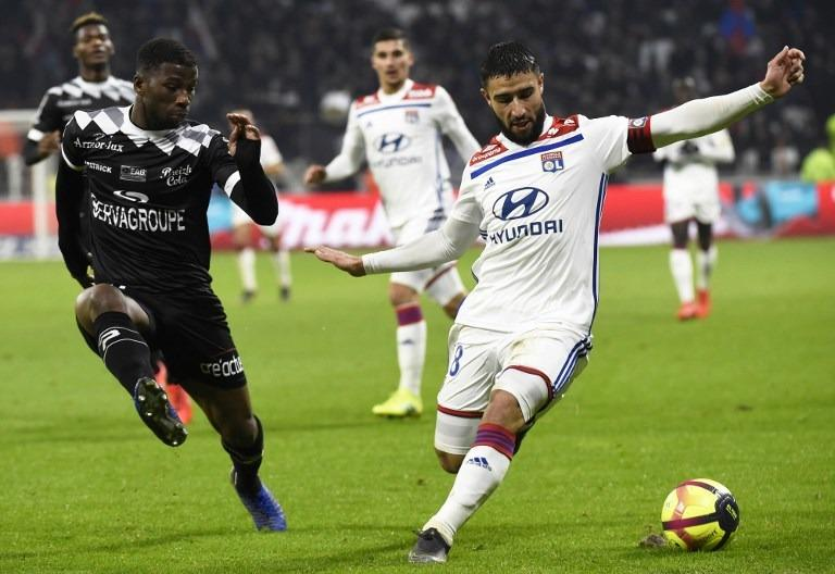 e206f967876 Guingamp s French defender Cheik Traore (left) vies for the ball with Lyon s  French forward Nabil Fekir during the French Ligue 1 football match between  ...
