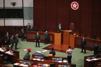 A session of HK's Legislative Council (LegCo) was disrupted Wednesday after an opposition lawmaker tried to hurl a container of decayed plants at the LegCo president.