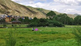 Residents in Yushu city of the Yushu Tibetan autonomous prefecture enjoy the greenery at a wetland park, a part of the reconstruction efforts after the earthquake in 2010.