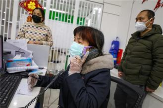 Residents in Wuhan, center of the new coronavirus outbreak, were engaged in all-out efforts to fight the disease.