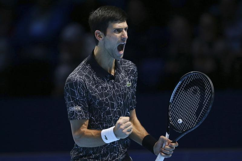 94a67a49 Novak Djokovic of Serbia celebrates winning a point against John Isner (not  in frame) of the United States in their ATP World Tour Finals tennis match  at ...