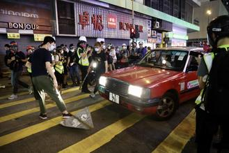 Acts of violence continued into the evening on Wednesday as radical protesters started fires and set up roadblocks in the heart of Mong Kok, one of Hong Kong's busiest districts.