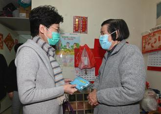 CE Carrie Lam and principal officials joined a number of non-governmental organizations in distributing surgical masks, food, health information leaflets and other supplies across districts.