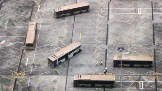 Buses are parked at the parking lot in the KMB Sha Tin Depot. From the bird's view, they are arranged in a funny fashion akin to the way block building games are played.