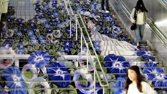 A painted staircase showing a girl surrounded by morning glories is seen at the front gate of JR Kumagaya Station in Kumagaya, Saitama prefecture.