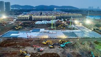Construction workers start building the Huoshenshan hospital - a makeshift hospital for novel coronavirus patients in suburban Wuhan, on Tuesday.