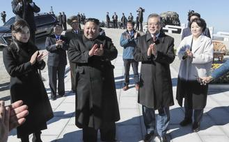 Leaders of the two Koreas stood on the peak of sacred Mount Paekdu volcano Thursday as they wrapped up their third summit since April.