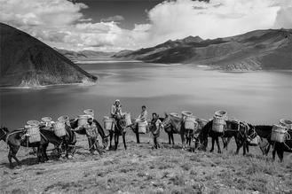 Wang Weitao captures the life of Tibetan's in a series of photographs which shows their spiritual world in different social contexts.