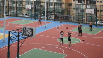 Local people brave the hot weather to play basketball in front of residential buildings in Kwun Tong district.