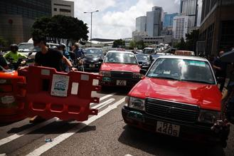 Protesters gathered around Wan Chai and Admiralty on Friday, disrupting traffic and forcing the Revenue Tower to close.