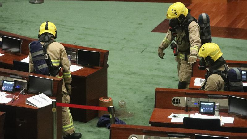 Firemen inspect the Legislative Council chamber after opposition lawmakers splashed a foul-smelling liquid inside during a meeting on the National Anthem Bill in Hong Kong, June 4, 2020. (CALVIN NG/CHINA DAILY)