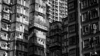 New residential towers loom over their time-worn forerunners in Cheung Sha Wan.
