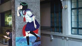 The uniformed animated girl on the wall at PMQ in Central is painted by a Hong Kong cartoonist