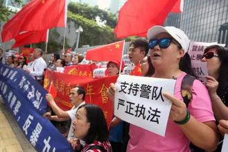 A group of local residents staged a rally outside the government headquarters on Monday in support of the newly enacted anti-mask law in Hong Kong.