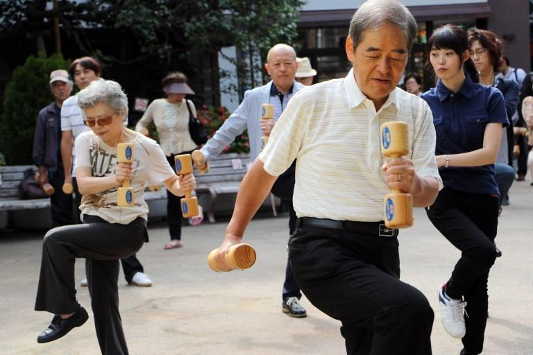 In This Photo Taken On Sept 21 2015 Elderly People Work Out With Wooden Dumb Bells In The Grounds Of A Temple In Tokyo To Celebrate Japans Respect For