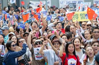 Hundreds of people stage a rally outside the government's headquarters in Admiralty in support of the city's police force.
