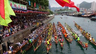 Rowers go all out in dragon boat race to mark the Dragon Boat Festival at Aberdeen fishing port in Hong Kong.