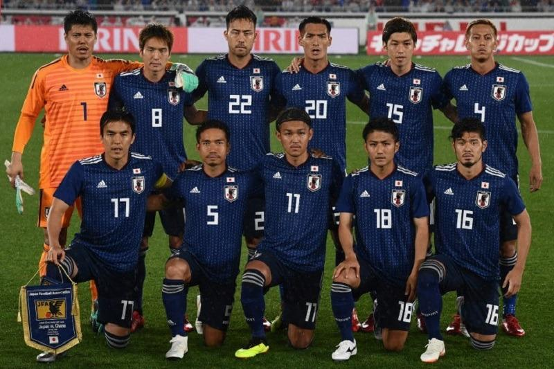 0fc4e1d518b Japan s National football team players pose prior the international  friendly football match between Japan and Ghana at the Nissan stadium in  Yokohama