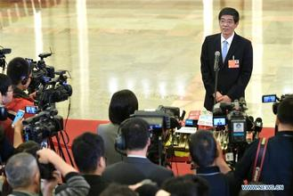 Ministers from different bureaus give interviews after a plenary meeting of the first session of the 13th NPC at the Great Hall of the People in Beijing Monday.