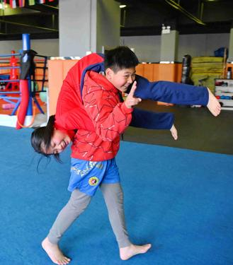 Boy trained by dad in martial art takes down bullies, becomes champion.