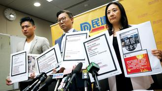 Members of the Democratic Alliance for the Betterment and Progress of Hong Kong addressed the media about online death threats against police officers and their families Tuesday.