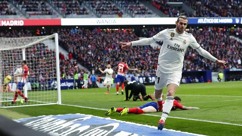 807179fea Real Madrid s Gareth Bale celebrates after scoring his side s 3rd goal  during a Spanish La Liga soccer match between Atletico Madrid and Real  Madrid at the ...