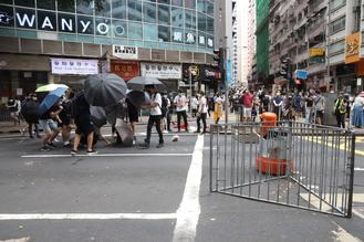 Bouts of violence and vandalism erupted at unlawful assemblies on Sunday, leaving some of Hong Kong's busiest streets paralyzed.