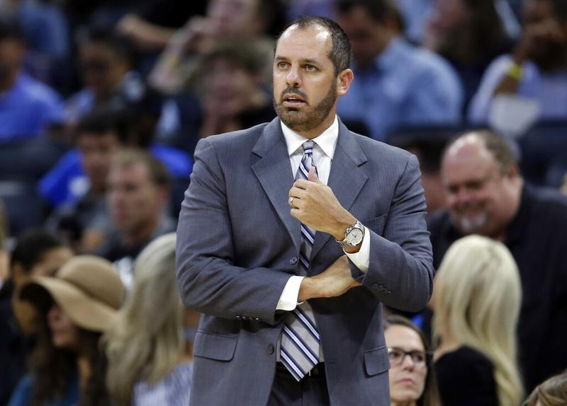 eb8eb7f1fd2 In this Oct 24, 2017 file photo, then Orlando Magic coach Frank Vogel  watches his team play the Brooklyn Nets during the first half of an NBA  basketball ...