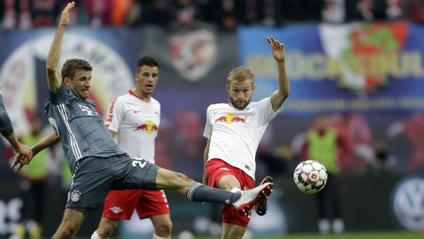Bayern forward Thomas Mueller, left, vie for the ball with Leipzig's Konrad Laimer during the German Bundesliga soccer match between Leipzig and Bayern Munich at the Red Bull Arena stadium in Leipzig, Germany