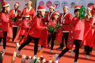 Hundreds of elderly Santa Claus dance with Children to celebrate Christmas and bless each other in Hong Kong.