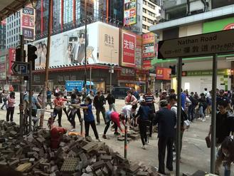 Residents from Sai Wan Ho, Mong Kok and Tin Shui Wai team up voluntarily to clear roads of debris put up by radicals.
