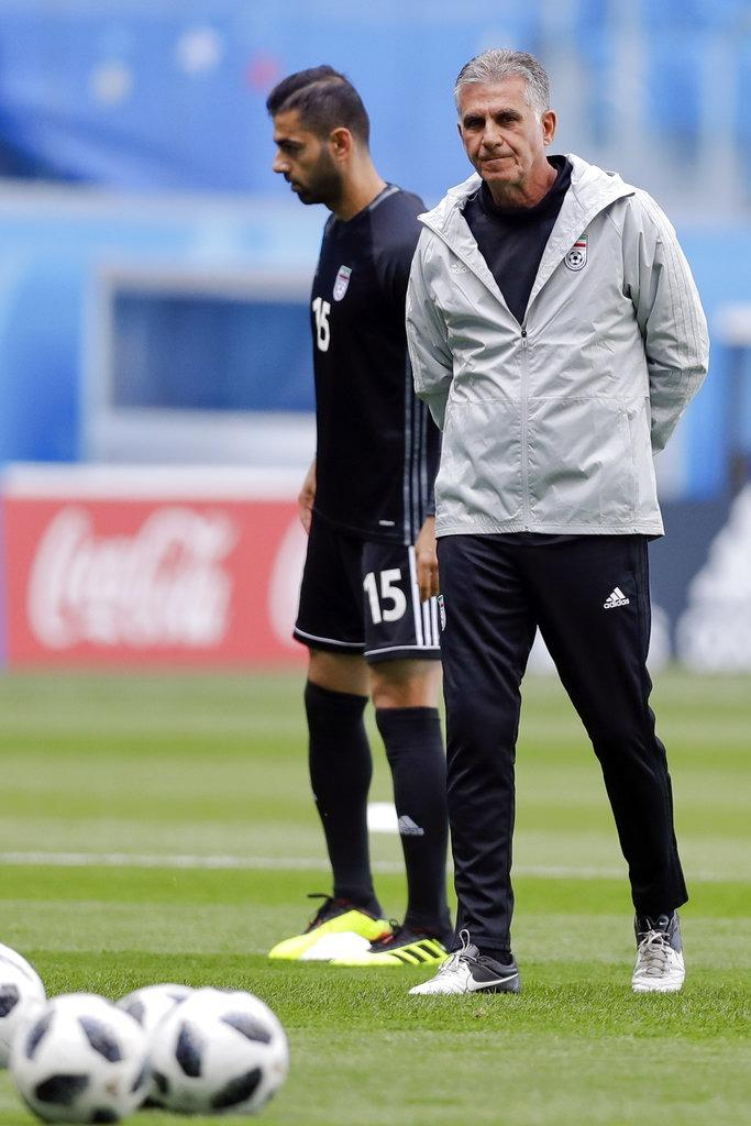 544dbc822 Iran s head coach Carlos Queiroz (right) walks on the pitch during the  official training of Iran on the eve of the 2018 World Cup Group B match  between ...